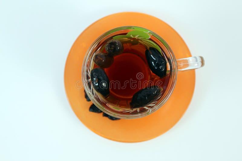 一个杯子玫瑰果茶 免版税图库摄影
