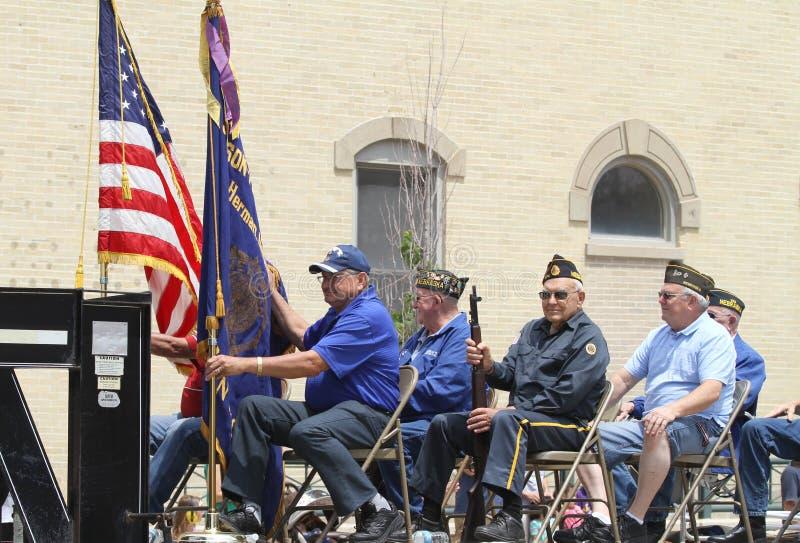 一个浮游物的五个更老的人在一次游行在小镇美国 免版税库存图片