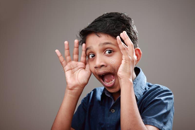 一个激动的年轻男孩 库存图片