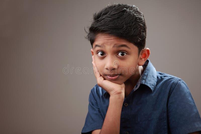 一个激动的年轻男孩 图库摄影