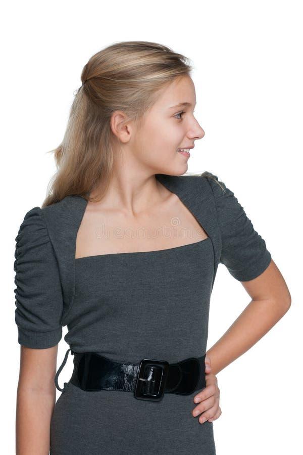 一个白肤金发的青少年的女孩的外形画象 库存图片