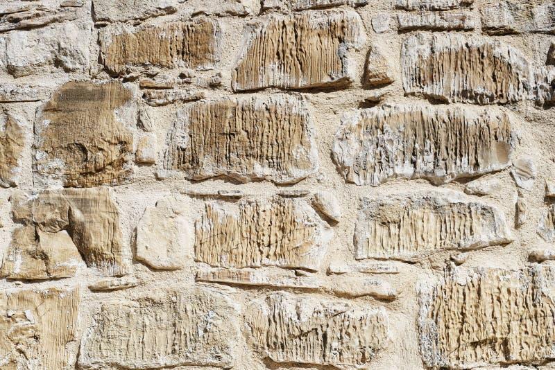 一个米黄砖墙的背景纹理 库存照片