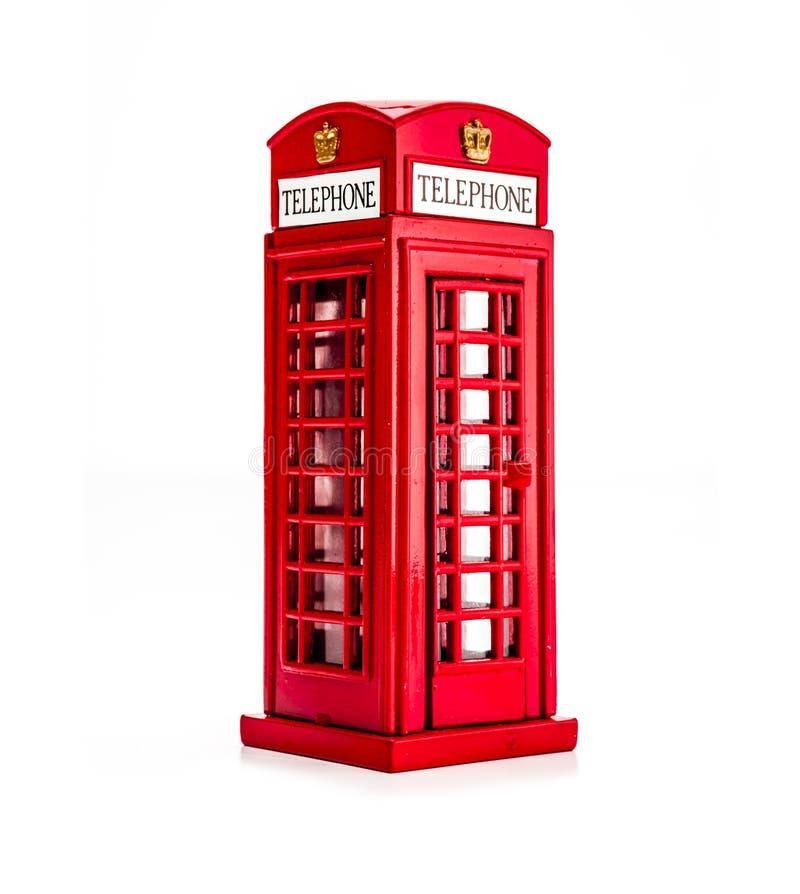 一个红色电话亭的模型隔绝了 库存图片