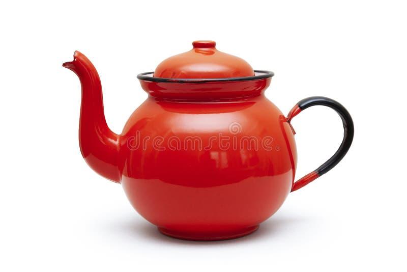 一个红色茶壶在白色背景的铁 库存图片