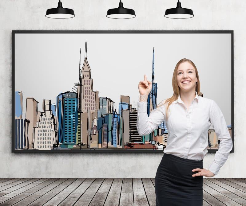 一个美丽的夫人指出纽约的图片在墙壁上的 木地板、混凝土墙和三黑天花板lig 皇族释放例证