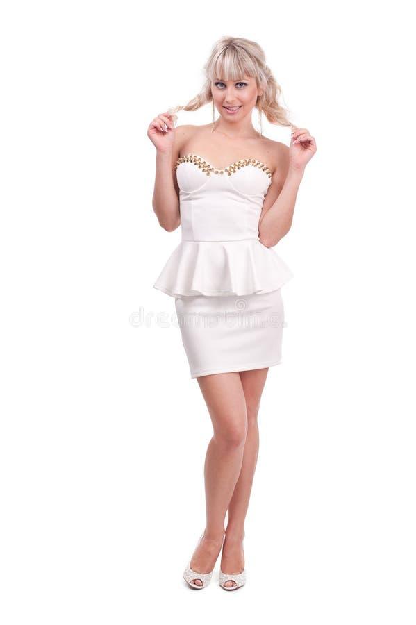 一个美丽的女孩的演播室照片白色背景的 图库摄影