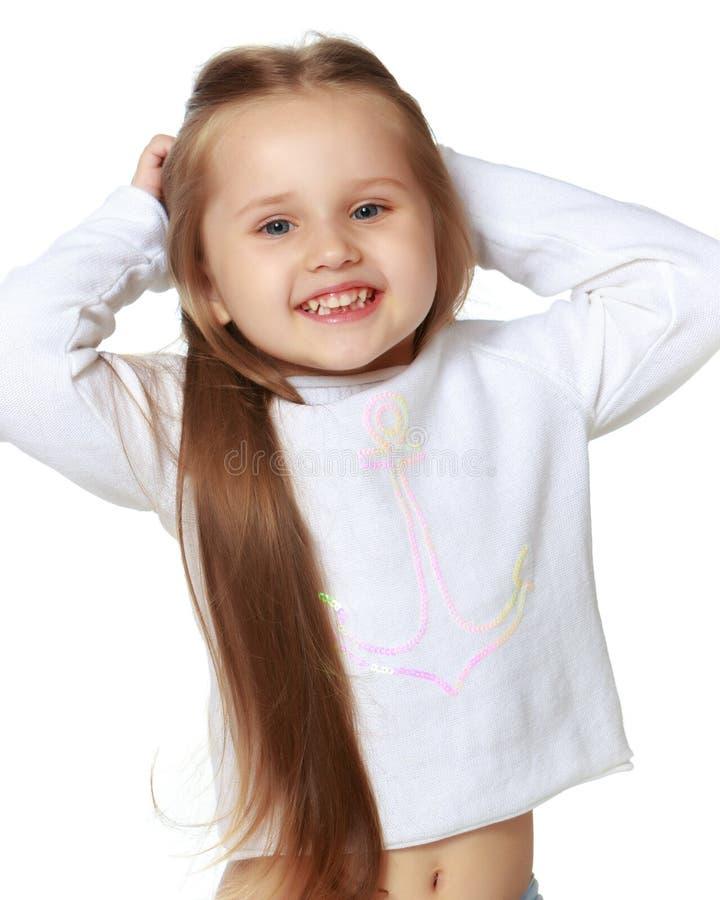 一个美丽的小女孩的画象. 健康, 滑稽.图片