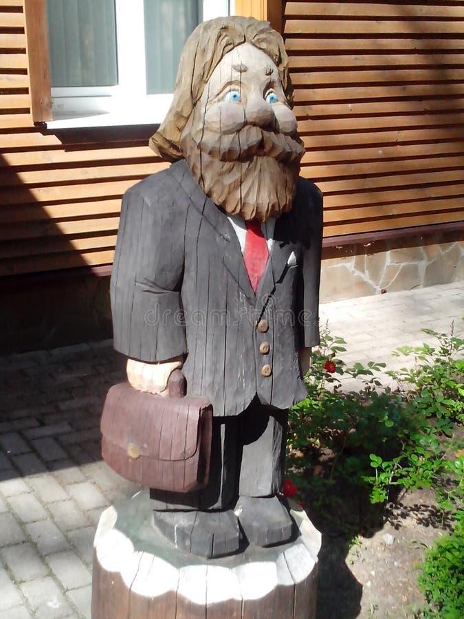 一个老人的图由木头制成 免版税库存图片