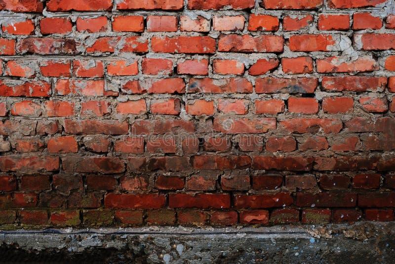 一个老房子的砖墙 一个老大厦的brickwall的纹理 砖砌特写镜头 建筑葡萄酒石工 库存图片