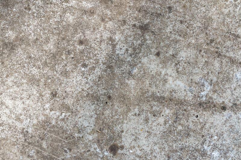 一个老混凝土墙的背景纹理有镇压的大模型或设计样式的在建筑、食物或者工业样品 库存图片