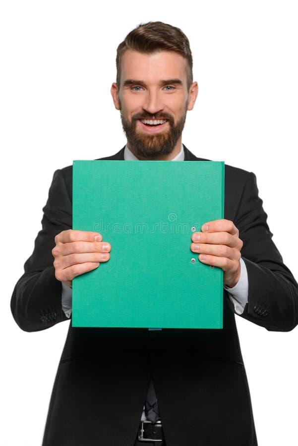 一个聪明的商人在被弄脏的背景中 库存图片