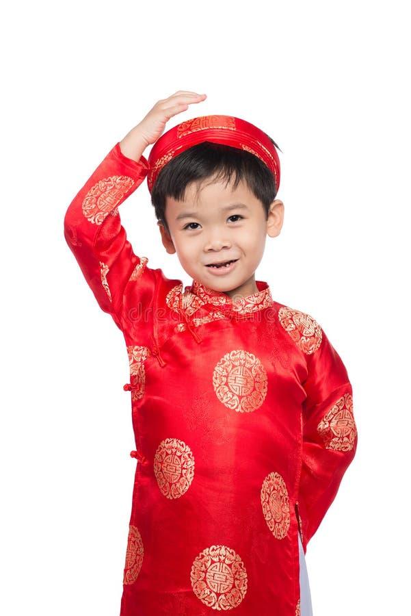 一个英俊的亚裔男婴的画象传统节日的co 免版税库存照片
