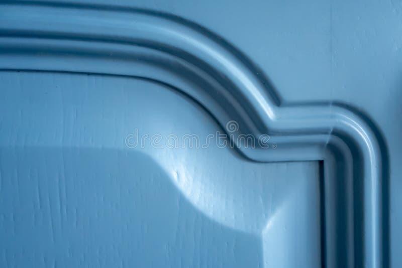 一个蓝色厨房门的片段 创造性的葡萄酒背景 免版税图库摄影