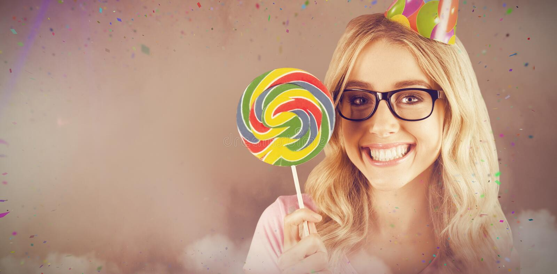 一个行家的画象的综合图象有拿着棒棒糖的党帽子的 图库摄影