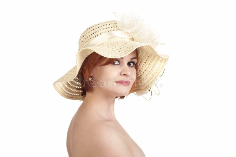 一个赤裸女孩和帽子的情感画象在白色背景 库存照片