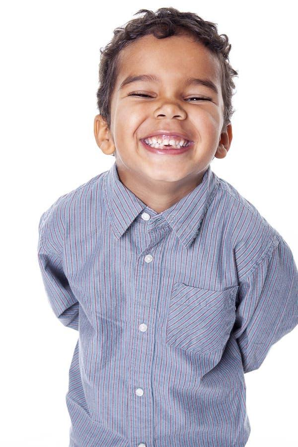 一个逗人喜爱的非裔美国人的小男孩的画象,隔绝在白色 图库摄影