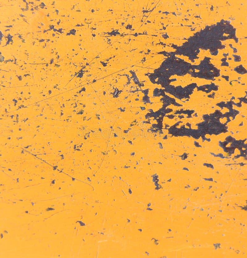一个金属表面的纹理与破裂的油漆的 库存图片