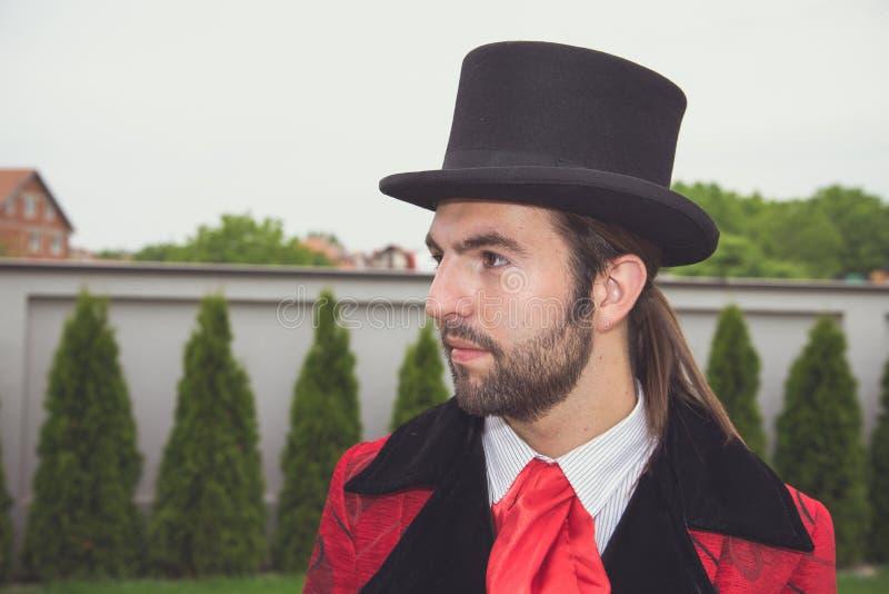 一个绅士的画象有高顶丝质礼帽的 库存图片