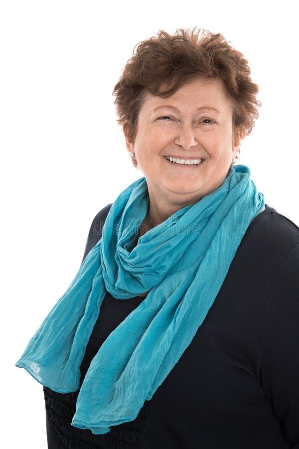 一个满意的微笑的老妇人的画象被隔绝在白色 免版税图库摄影