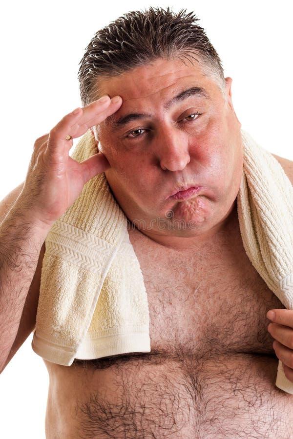一个exausted肥胖人的特写镜头画象在做以后的行使 免版税库存图片