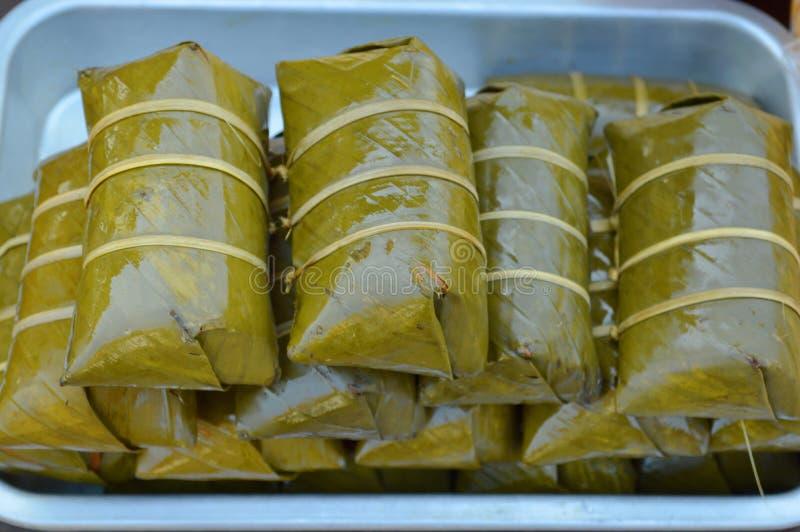 一些泰国蜜钱、Khao疯狂的汤姆或Khao汤姆垫 免版税库存图片