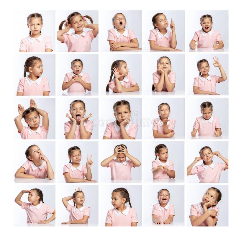 一件桃红色夹克的学校女孩用不同的情感 r 免版税库存照片