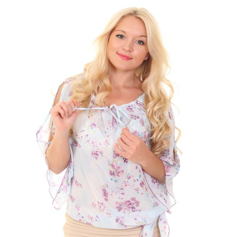 一件轻的夏天女衬衫的年轻金发碧眼的女人 图库摄影