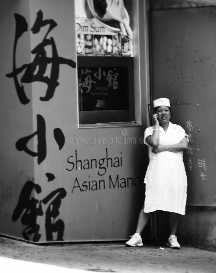一位亚裔厨师的画象在唐人街,纽约 免版税库存图片