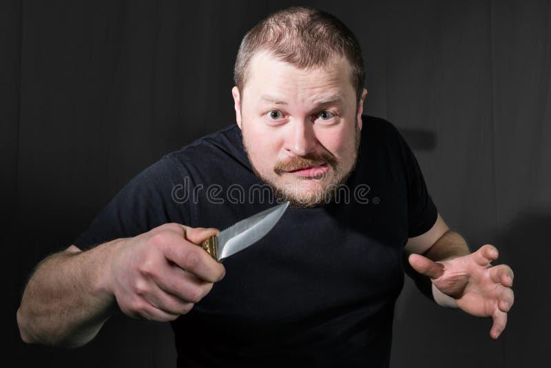 一位匪徒的画象有刀子的 库存照片