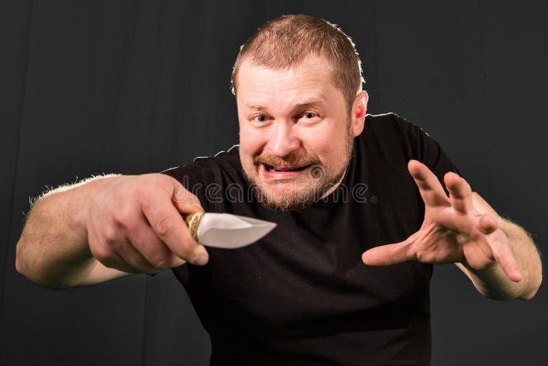 一位匪徒的画象有刀子的 免版税库存图片
