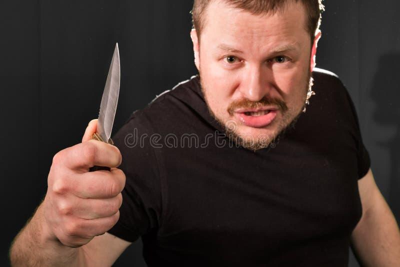 一位匪徒的画象有刀子的 库存图片