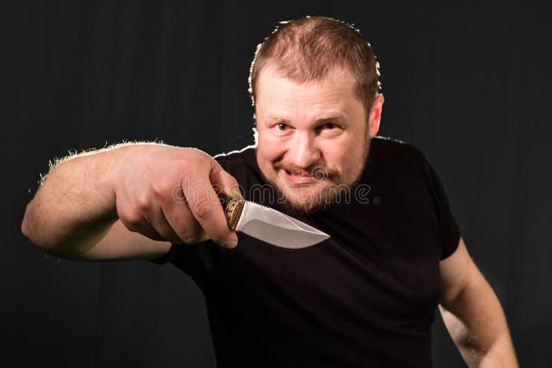 一位匪徒的画象有刀子的 图库摄影