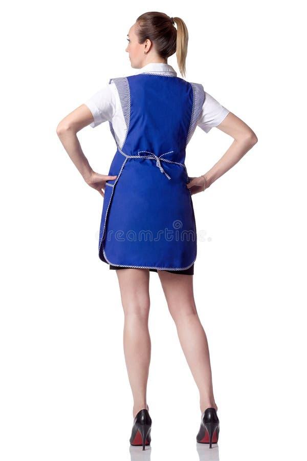 一位女性推销员的背面图在穿制服的市场上 免版税库存照片