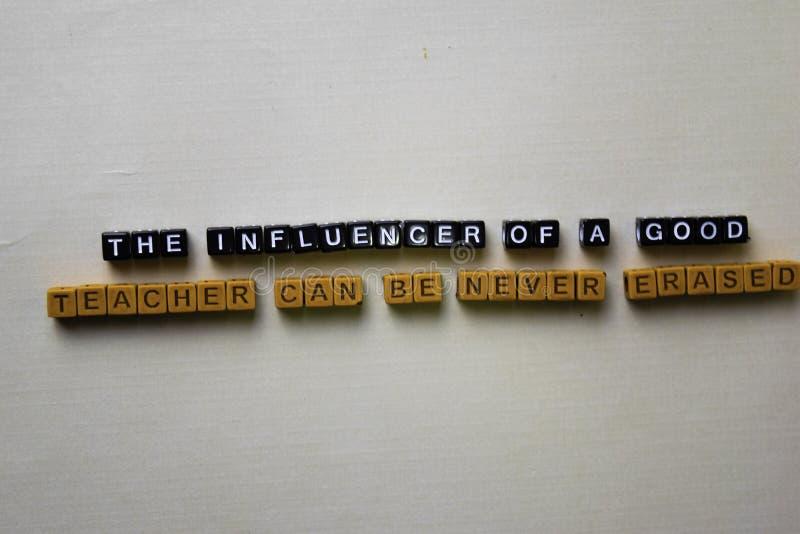 一位好老师的Influencer在木块不可以删掉 启发概念 库存图片