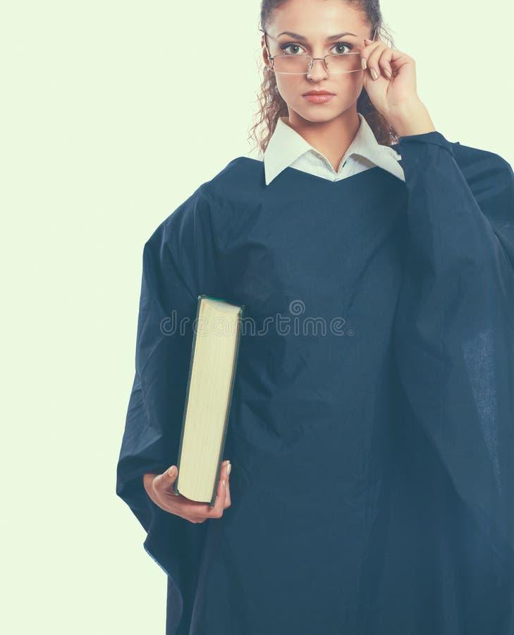 一位年轻女性法官的画象,隔绝在白色背景 库存图片