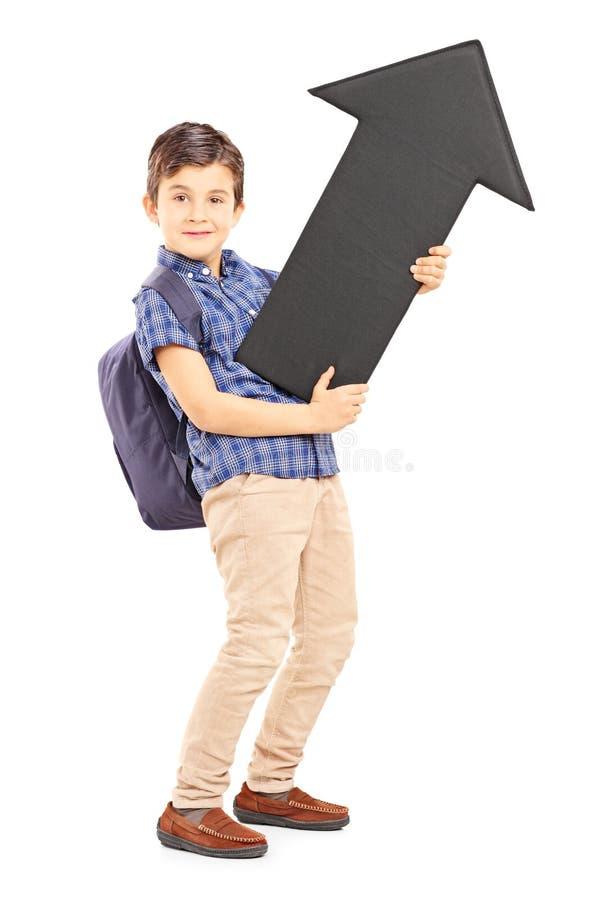 一位男小学生的全长画象有举行大黑色的袋子的 免版税库存图片