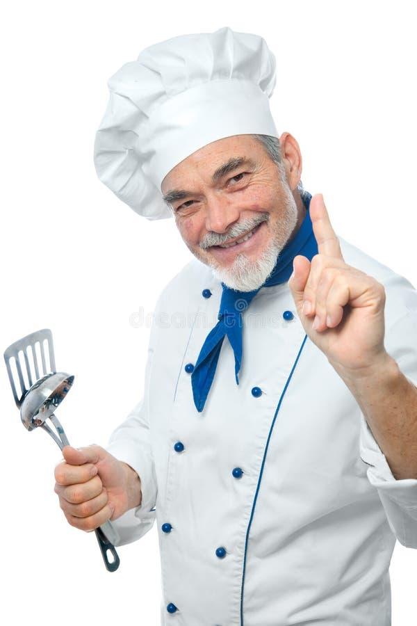 一位英俊的主厨的纵向 免版税库存照片
