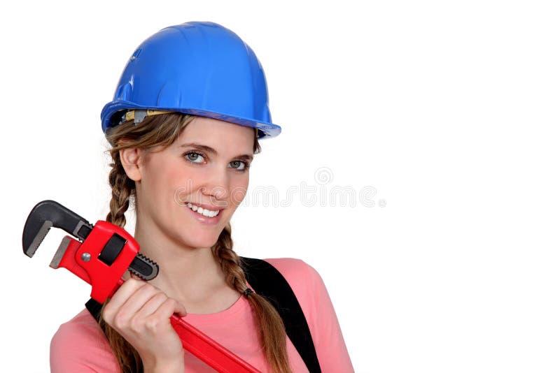一位逗人喜爱的女性管道工。 库存照片
