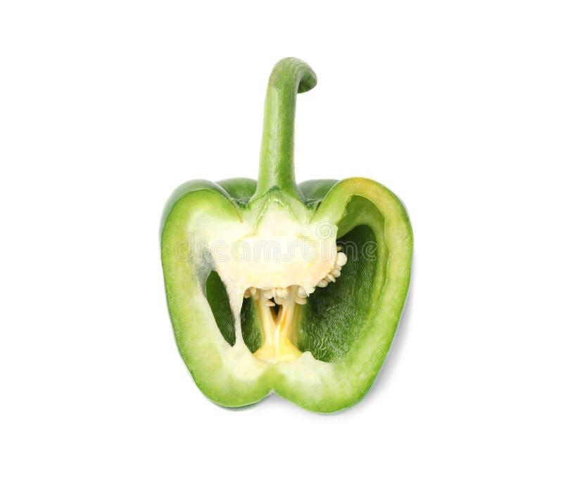 一半在白色的新鲜的成熟青椒 库存照片