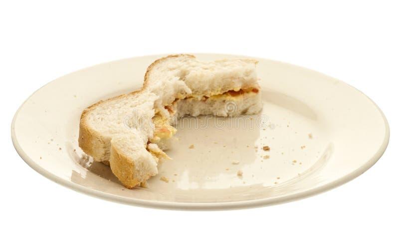 一半被吃的三明治 免版税库存照片