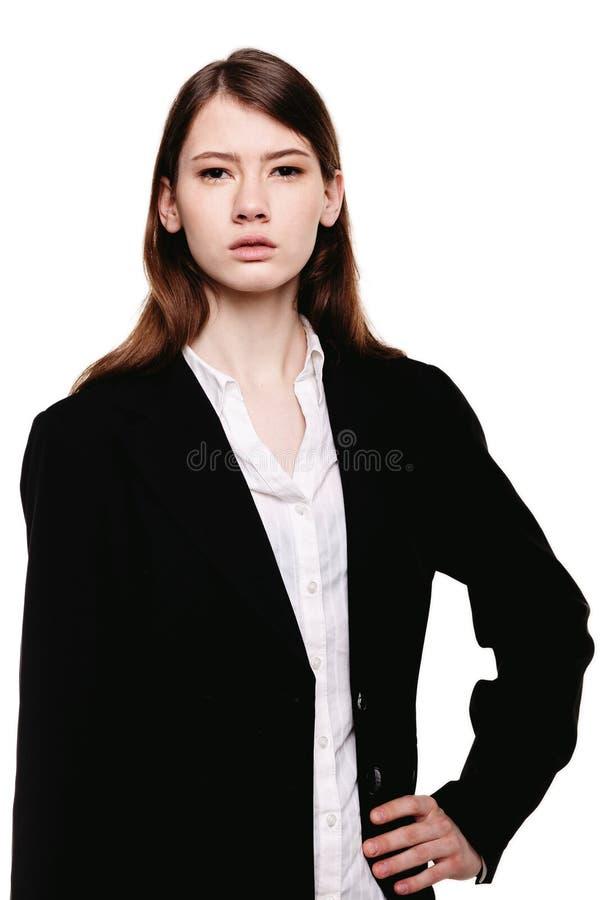 一只年轻俏丽的女实业家手的特写镜头在臀部的 库存图片