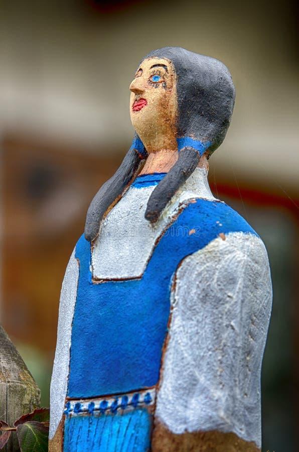 一名农民妇女的陶瓷玩偶 库存图片