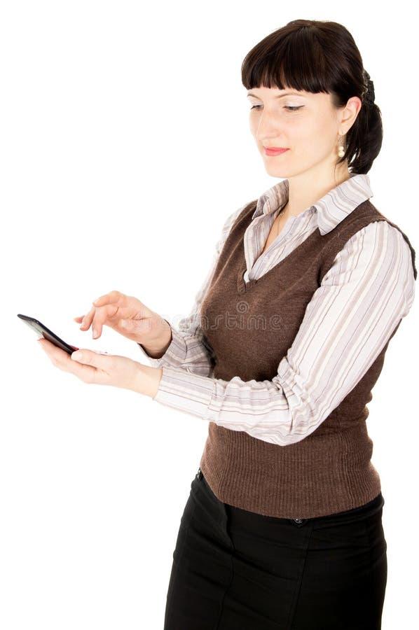 一名在移动电话的美好的新深色头发的妇女收益 库存照片