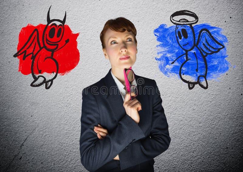 一名女实业家和恶魔的数字图象有天使的 免版税库存照片