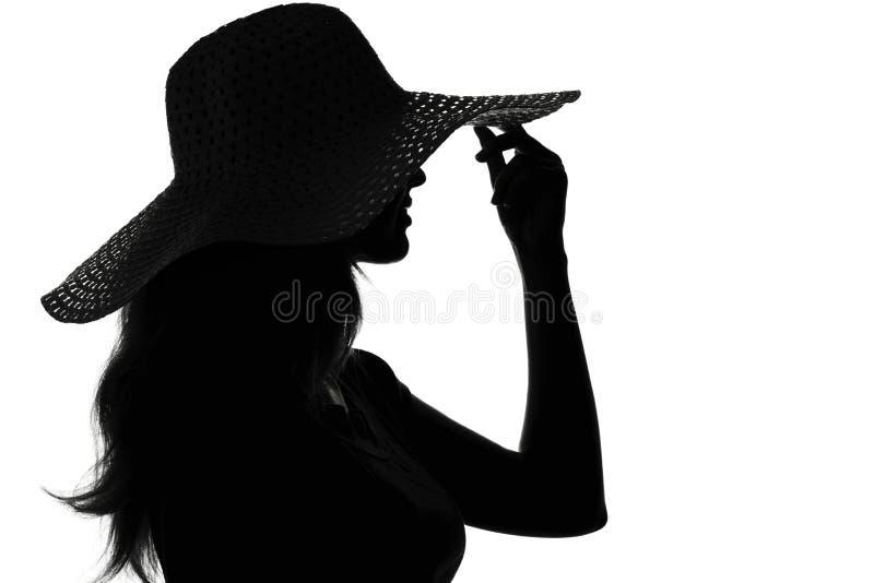 一名妇女的剪影帽子的 库存照片