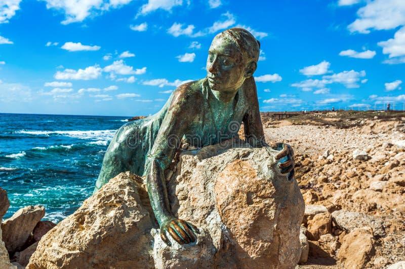 一名妇女的雕象石头的 免版税图库摄影