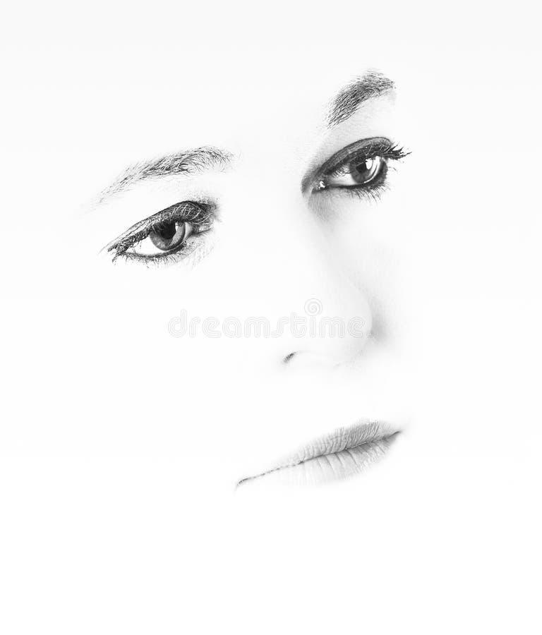 一名妇女的高关键画象有空的表示的在她的面孔 免版税图库摄影