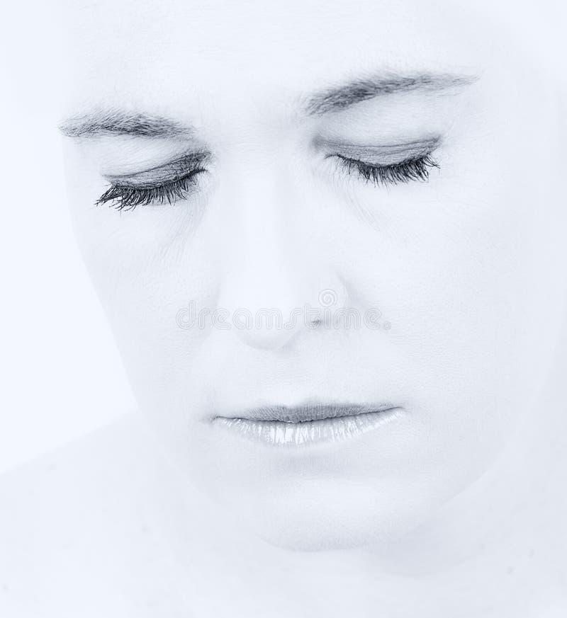 一名妇女的高关键画象有空的表示的在她的面孔 库存照片