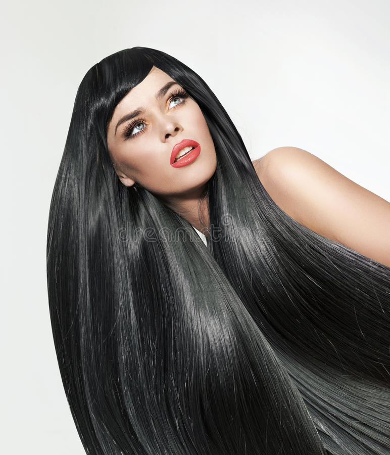 一名妇女的画象有长期的 平直和分蘖性头发 免版税库存图片