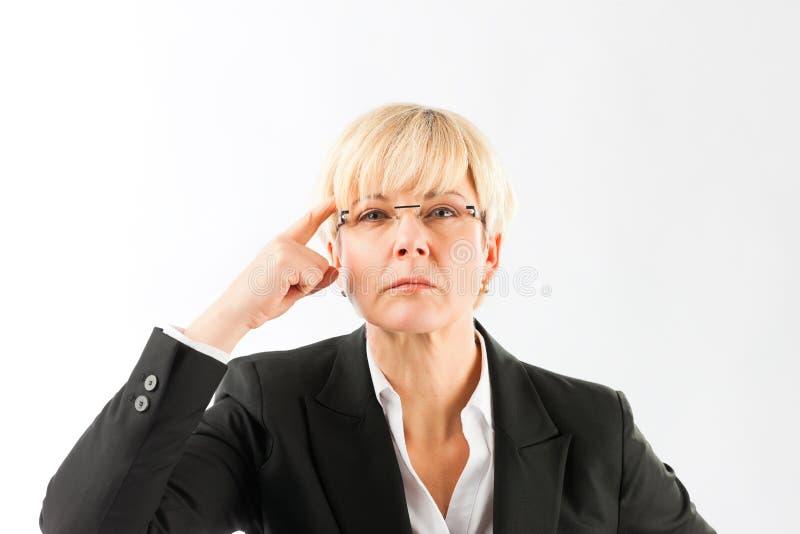 一名恼怒的成熟女实业家 库存照片